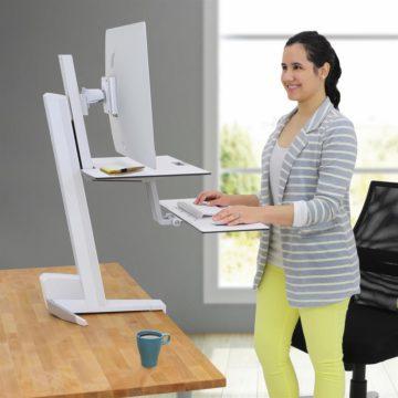 Woman using ergonomic standing desk